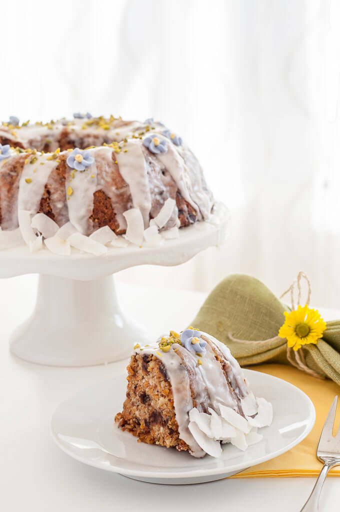 Gluten-free Vegan Carrot Cake Recipe with Icing #Easter #nuts #chocolate chips