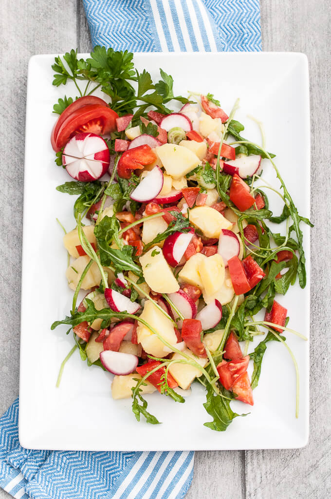 Healthy Vegetable Potato Salad Recipe w/ Bell peppers, tomatoes, radishes, arugula and more! No mayo ;) - VeganFamilyRecipes.com - #vegetables #potatoes